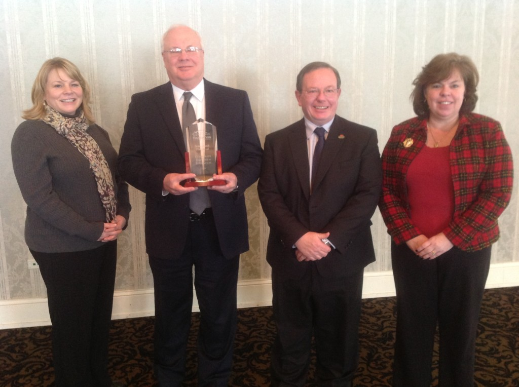Jodi Ehrenberger, Bruce Norgaard, Wayne Oliver, and Andrea Nerby of State Bank Financial receive the 2014 Corporate Partner in Education Award.