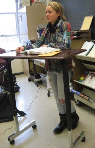 Central Sophomore Sara Brekke demonstrates use of a standing desk.
