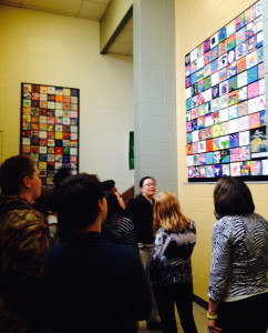 Longfellow students and staff enjoy the official installation of Compassion Project tiles.