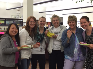 Among those enjoying Thank a Teacher Day at North Woods Elementary School was Carol Taebel (center, holding bananas). Treats for nearly 1,000 employees were provided through grant support from the La Crosse Community Foundation Carol and Duane Taebel Family Fund. Carol's daughter, Heidi Morris  (to the immediate right of Carol) is an ELL teacher at North Woods. Others, from left, are: Cathy Leon, a student teacher;  Tara Schuttenhelm, grade 2 teacher; Heidi Wysocik, grade 3 teacher;  Carol Taebel and Heidi Morris; and Stephany Beckstrom, a grade 3 teacher.