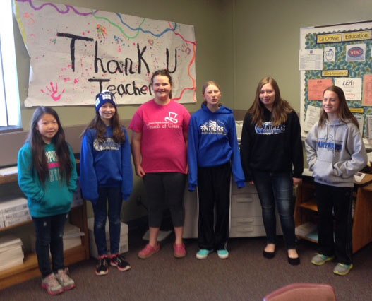 At Logan Middle, teachers were cheered by students, from left: Mai Doua Xiong, Marlie Voigt, Emily Flottmeyer, Ella Bachim, Ashley Anderson and Ellie Solberg.