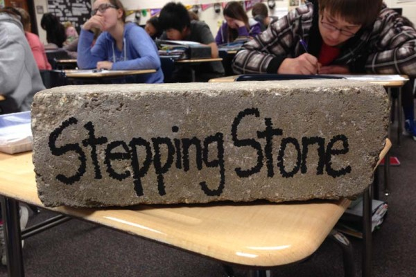 "Students in Logan's AVID class stand on this stepping stone when sharing with the class. One student explained: ""Stumbling blocks are things that might be bad ... so you step off it and learn from your mistakes."""