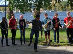 One of the saxophone players jumped out in front to dance during a Chili Cook Off performance by a band of students from Longfellow Middle School and Central High School.