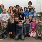 Amanda Wolfgram and students at North Woods International School - with LPEF Board Secretary Judy Sleik in the back. North Woods received a $253 grant to update board games used in an after-school club.