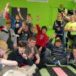 Students at La Crosse Design Institute raise hands to show their interest in using new animation software to be purchased with a $1,300 LPEF grant.