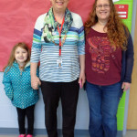 Principal Laura Huber, center, and art teacher Amoreena Rathke, right, with student Kacia Pond at Northside Elementary - Northside and Hamilton will share a $1,500 grant for visiting artist Tyanna Buie, who uses art as a way to help children cope with trauma.