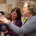 Spence teacher Ronnah Metz demonstrates Lux Blox to LPEF Board Member Margaret Dihlmann-Malzer -- Ronnah and Emerson teacher Jean Crayton share in a $799 grant to buy the innovative construction blocks for use in teaching art, math, science and engineering skills.