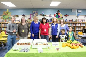 Emerson teacher Chandler Campbell, parent Tracy Bast, teachers Jackie Goetsch and Val Glotfeldy, board members Julie Nelson and Rochelle Nicks with Edison and Oliver