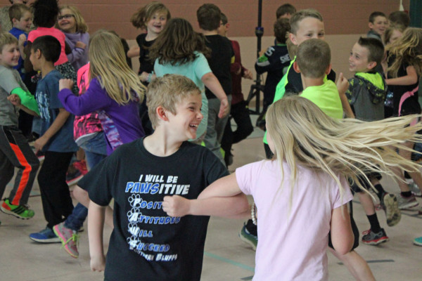 2nd-graders Rylee Danielson and Jazzlyn Pate spin around the dance floor.