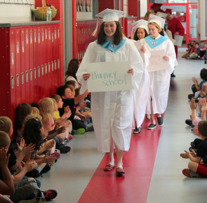Ann Petersen leads the march down the hallways at Northside Elementary School.