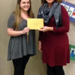 Hamilton/SOTA I Art Teacher Bethany Nugent receives a $1,000 grant from LPEF Grants Committee Chair Cari Mathwig Ramseier.