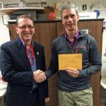 "Brad Quarberg presents a grant to Logan High's Steve Johnston for the Logan ""Exo Arm"" project."