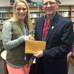 Logan Middle Teacher Cassandra Sturzl accepts her grant from Brad Quarberg.