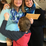LPEF's Tammy Larson shares a fun moment delivering a grant to Anne Seehafer, executive director of GROW La Crosse.