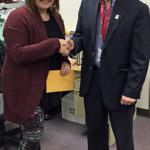 Teacher Whitney Redman of Logan High, congratulated by School Board Member Brad Quarberg, who also serves on the LPEF Board.