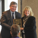 Superintendent Randy Nelson presents Leadership Award to Annette O'Hern.