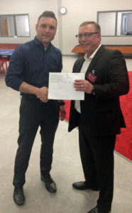 Brad Skaer, left, accepts his grant from Scott Mihalovic, to create a test aquaponics program for students in the Integrated Supports program at the Boys & Girls Club-Erickson site.