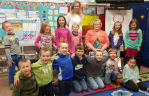 Emerson teachers Jill Fink (in white at back) and Tami Hillestad (in orange sweater) with first-graders.