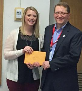Spence Teacher Katie Jeseritz receives her grant from Board of Education and LPEF Board Member Brad Quarberg.