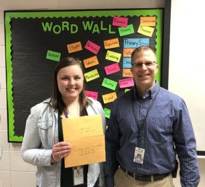 Teacher Megan Weiser and Dean of Students Peter Schmitz accepted two grants on behalf of Logan Middle School.