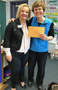 LPEF Board President Shawn Dutchin presents a grant to North Woods Teacher Rose Kulig.