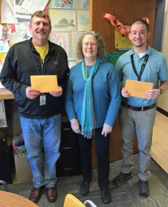 Two grants were awarded to Hamilton Elementary by Board Member Margaret Dihlmann-Malzer, pictured here with Principal Steve Michaels (left) and Teacher Austin Mickschl (right).